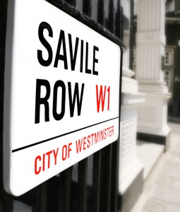 A close up view of the street sign on Savile Row, London. Savile Row is a road in the City of Westminster in central London. The Row is the major centre of traditional bespoke tailoring, primarily for men., Savile Row, London, London, England.