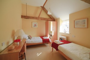 An interior view of a double bedroom at Ellwood Cottages, a set of self catering holiday cottages in rural Dorset., Woolland, Dorset, England. Additional Credit: Tourism For All
