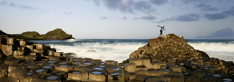 Athlete throwing a discus on Giants Causeway, County Antrim, Northern Ireland